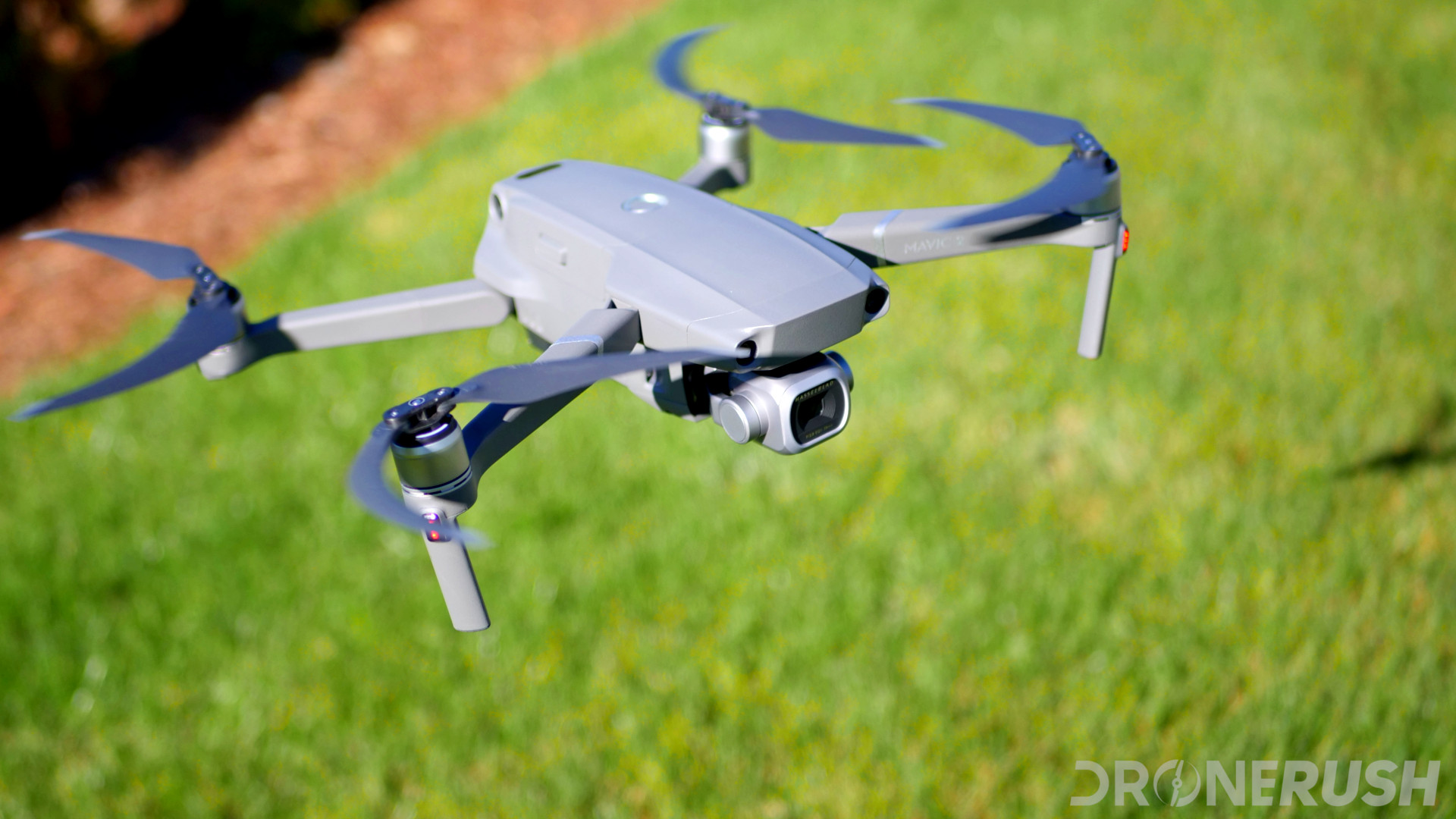 DJI Mavic 2 Pro flying top grass