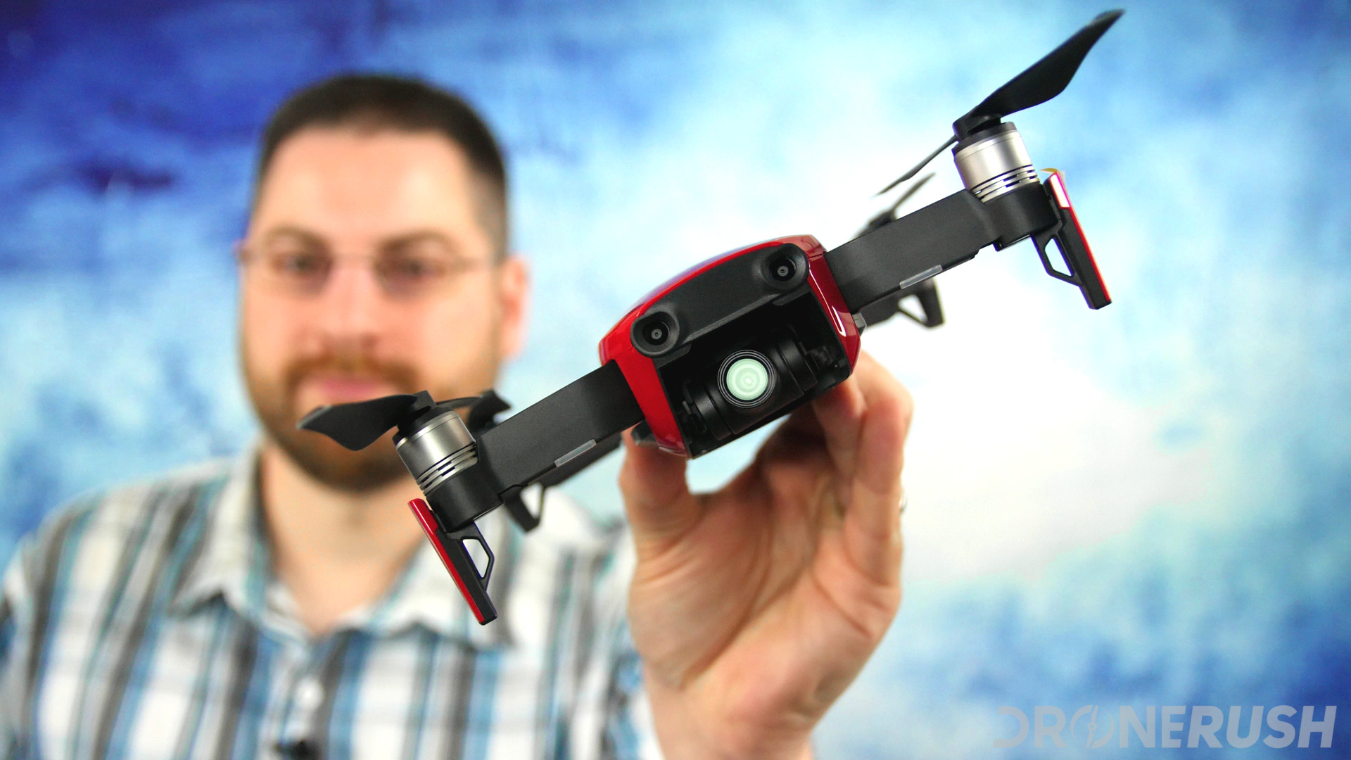 Jonathan Feist holding red DJI Mavic Air camera flare